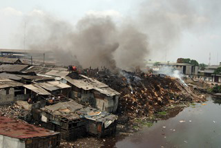Pollution caused by burning waste and overcrowding - photo courtesy of Johnny Greig: www.JohnnyGreig.com